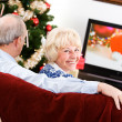 Christmas: Couple Sitting And Watching Holiday Television — Stockfoto