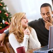 Stock Photo: Christmas: Couple Discussing What They Want For Christmas