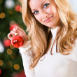 Christmas: Holding A Christmas Ornament — Stockfoto