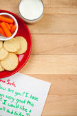 Christmas: Plate of Cookies for Santa and Carrot for Reindeer — Stock Photo