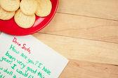 Christmas: Cookies for Santa and Wish List — Stock Photo