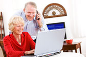 Seniors: Senior Couple Gets Telephone Support For Computer — Stock Photo
