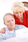 Seniors: Couple Upset At Amount Of Bills — Stock Photo