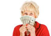 Seniors: Woman Holding Up Money Fan — Stock Photo