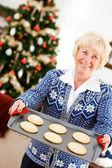 Christmas: Woman Holding Tray Of Christmas Cookies — Stock Photo