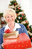 Christmas: Senior Woman Holding Christmas Gifts — Fotografia Stock