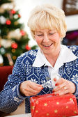 Christmas: Pulling Off Tape To Seal Gift — Stock Photo