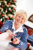 Christmas: Senior Woman Wrapping Gifts — Stock Photo