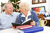 Christmas: Couple Looking at Scrapbooks — Stock Photo
