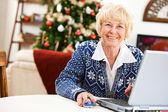 Christmas: Senior Woman Online — Stock Photo