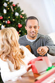 Christmas: Man Wants To Know What's In Box — Stock Photo