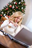 Christmas: Woman Tearing Up Bank Check — Stock Photo