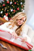 Christmas: Woman Wrapping Gift Box — Stock Photo