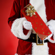 Stock Photo: Santa: Hands Full Of Christmas Presents