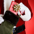 Santa: Pulling A Gift Out Of Stocking — Stockfoto