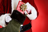 Santa: Pulling A Gift Out Of Stocking — Stock Photo