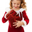 Christmas: Little Girl Opens Christmas Box — Stockfoto