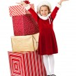 Stock Photo: Christmas: SantGirl By Stack of Gifts