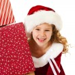 Christmas: Little Girl Peeks From Behind Gifts — Lizenzfreies Foto