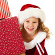 Christmas: Little Girl Peeks From Behind Gifts — ストック写真