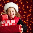 Christmas: Girl With Presents Glances to Side — Stockfoto
