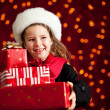 Christmas: Girl With Presents Glances to Side — Lizenzfreies Foto