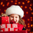 Stock Photo: Christmas: Carrying Big Stack Of Christmas Gifts