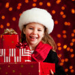 Christmas: Cute Girl With Holiday Gifts — Stock Photo