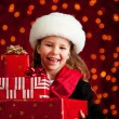 Christmas: Cute Girl With Holiday Gifts — Stockfoto