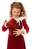 Christmas: Little Girl Opens Christmas Box — Stock Photo
