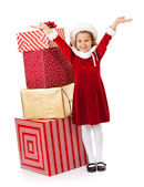 Christmas: Santa Girl By Stack of Gifts — Stock Photo