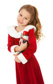 Christmas: Cute Girl With Nutcracker Doll — Stock Photo