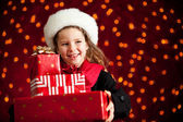 Christmas: Girl With Presents Glances to Side — Stock Photo