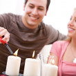 Valentine's: Man Lights Romantic Candles — Stock Photo