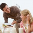 Stock Photo: Valentine's: MSurprises Girlfriend with Dinner