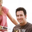 Valentine's: Woman Serving Dinner To Man — Stock Photo