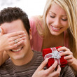 Stock Photo: Valentine's: WomSurprises MWith Gift