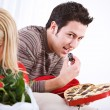Valentine's: Man Sneaks Candy From Box — Stock Photo #38008463
