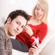 Stock Photo: Valentine's: MHolding Small Gift For Girlfriend