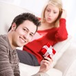 Valentine's: Man Holding Small Gift For Girlfriend — Stock Photo