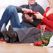 图库照片: Valentine's: Couple Having Champagne and Candy