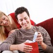 Valentine's: Man Gets TV Remote Gift — Stock Photo