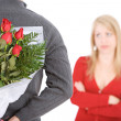 Valentine's: Man With Roses Behind His Back — Stock Photo