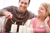 Valentine's: Man Lights Romantic Candles — Stock Photo
