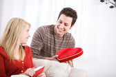 Valentine's: Man Give Candy Heart Box To Girlfriend — Stock Photo