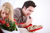 Valentine's: Man Sneaks Candy From Box — Stock Photo