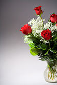 Valentine: Red Rose Bouquet in Vase — Stock Photo