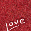 Glitter: Love Written in Red Glitter Background — Stock Photo
