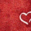 图库照片: Glitter: Red Glitter With Heart Drawn Background