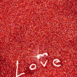 Glitter: Love Written in Red Glitter Background — Foto Stock #38151319